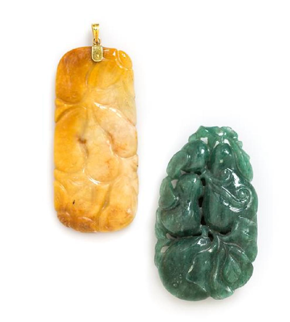 * A Collection of Carved Jade and Hardstone Pendants,