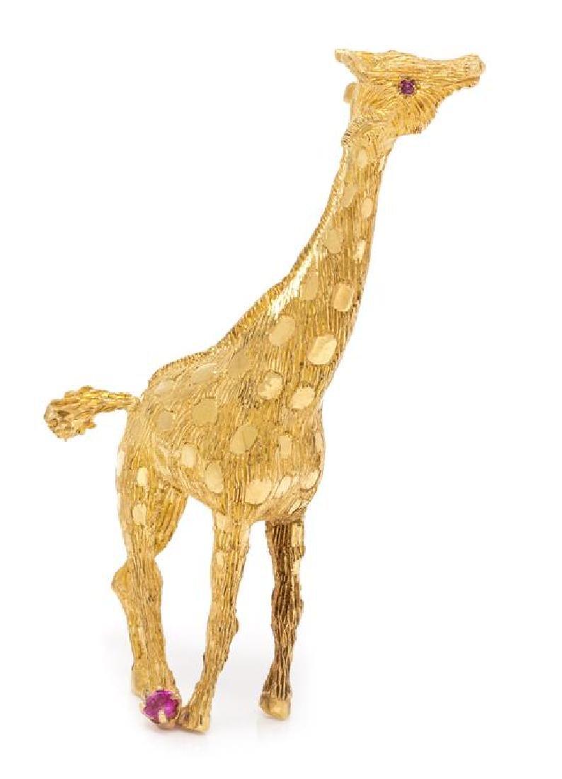 7104d101f85e8 An 18 Karat Yellow Gold and Ruby Giraffe Brooch, 14.55