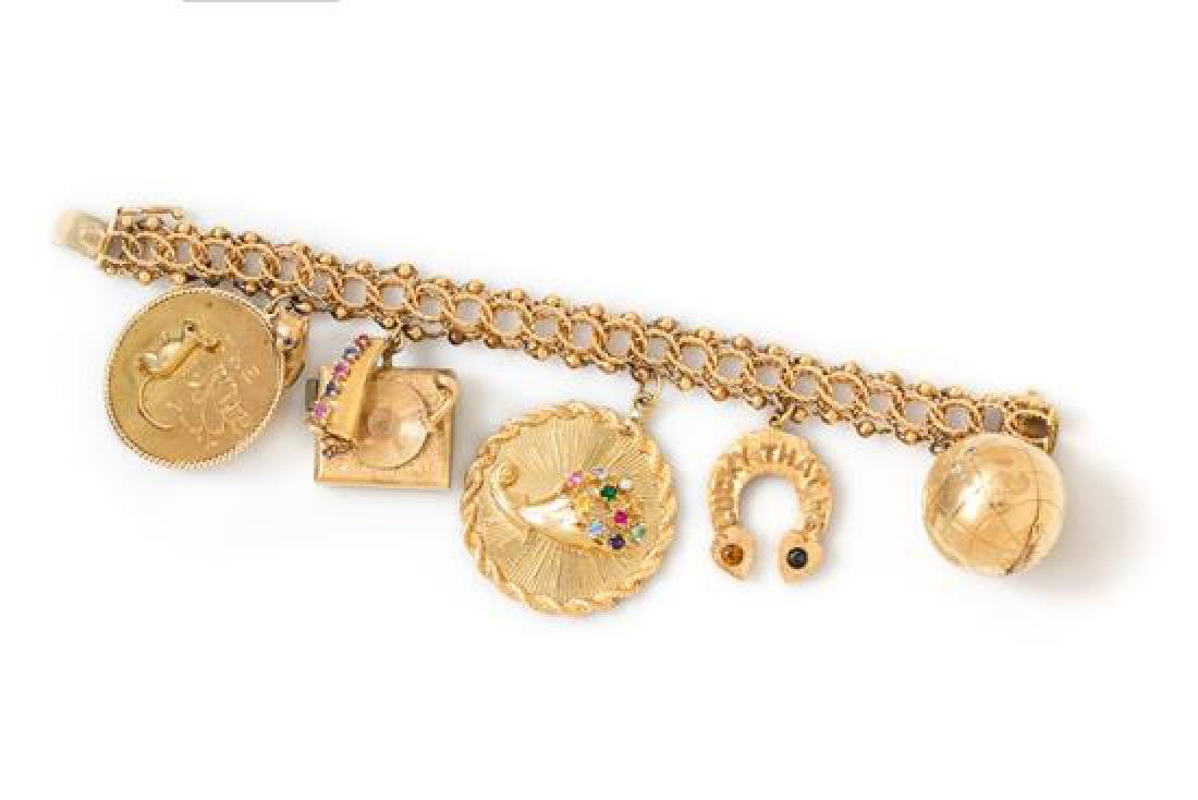 A Yellow Gold Charm Bracelet with Five Attached Charms,