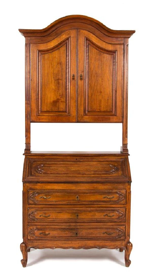 A French Provincial Carved Fruitwood Secretary Desk