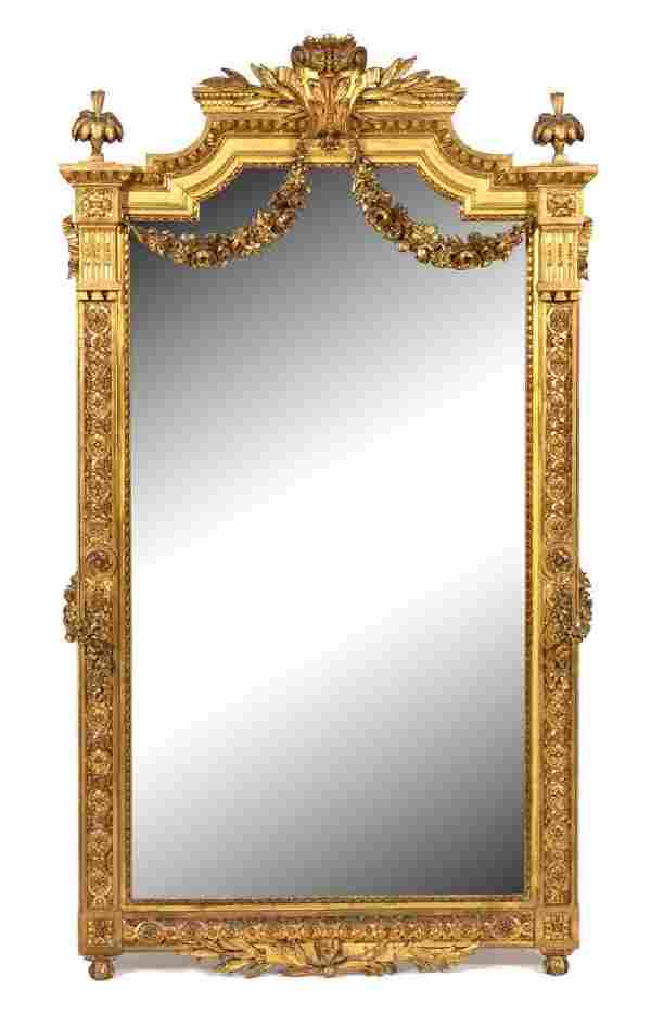 A Louis XVI Style Carved Giltwood Mirror Height 57 1/2