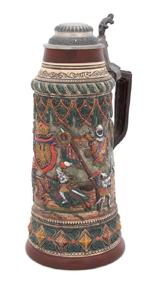 A Mettlach Polychrome Stoneware Beer Stein with Pewter