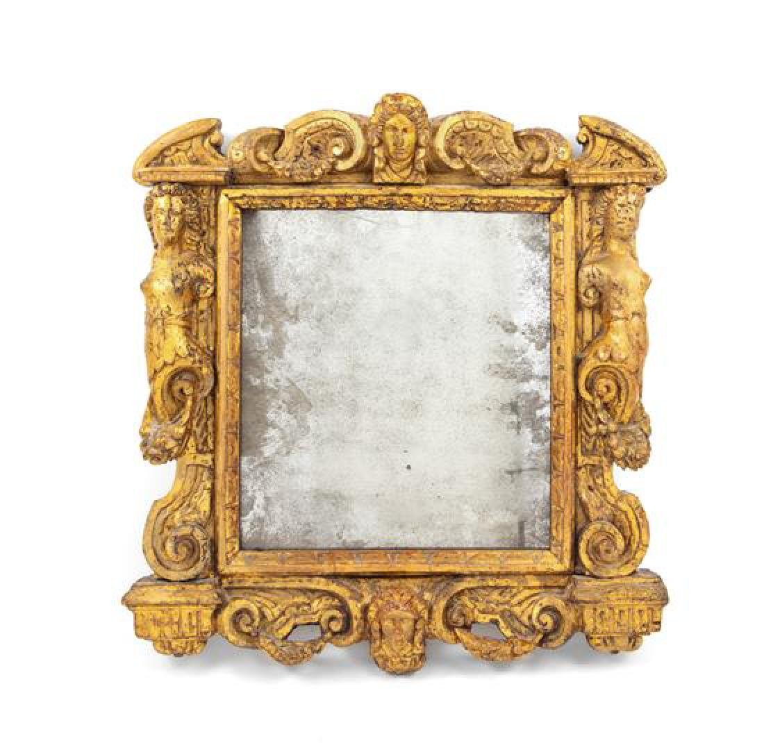 An Italian Giltwood Mirror Height 22 x width 20 inches.