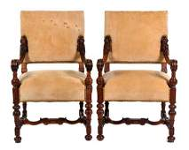 A Pair of Continental Walnut Armchairs Height 39