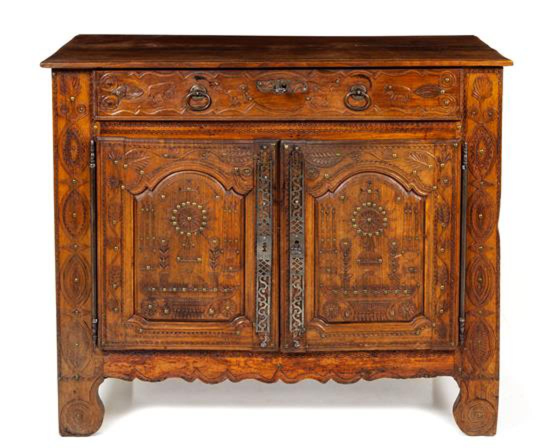 A Louis XV Provincial Carved Walnut Cabinet Height 40