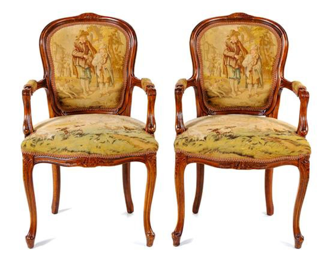 A Pair of Louis XV Fruitwood Fauteuils Height 37
