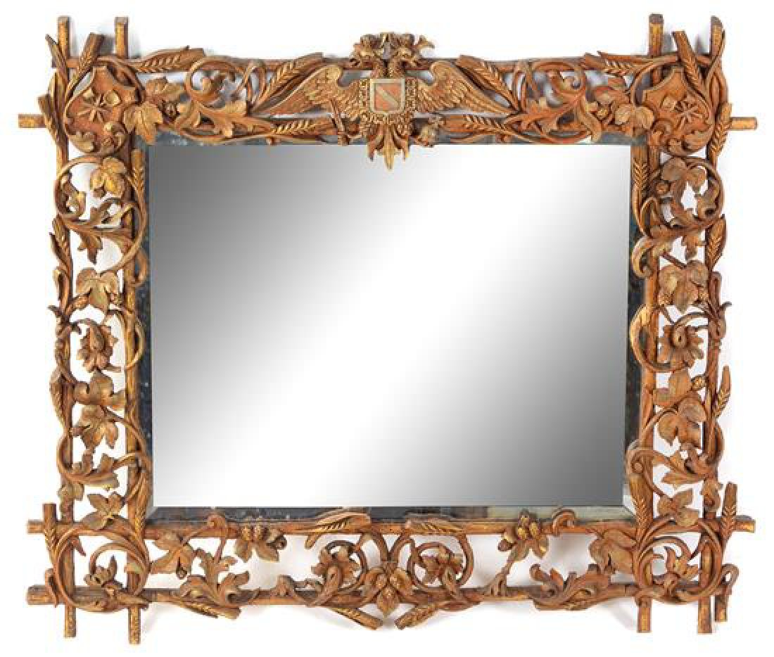 A Black Forest Carved Mirror Height 26 x width 29 1/2