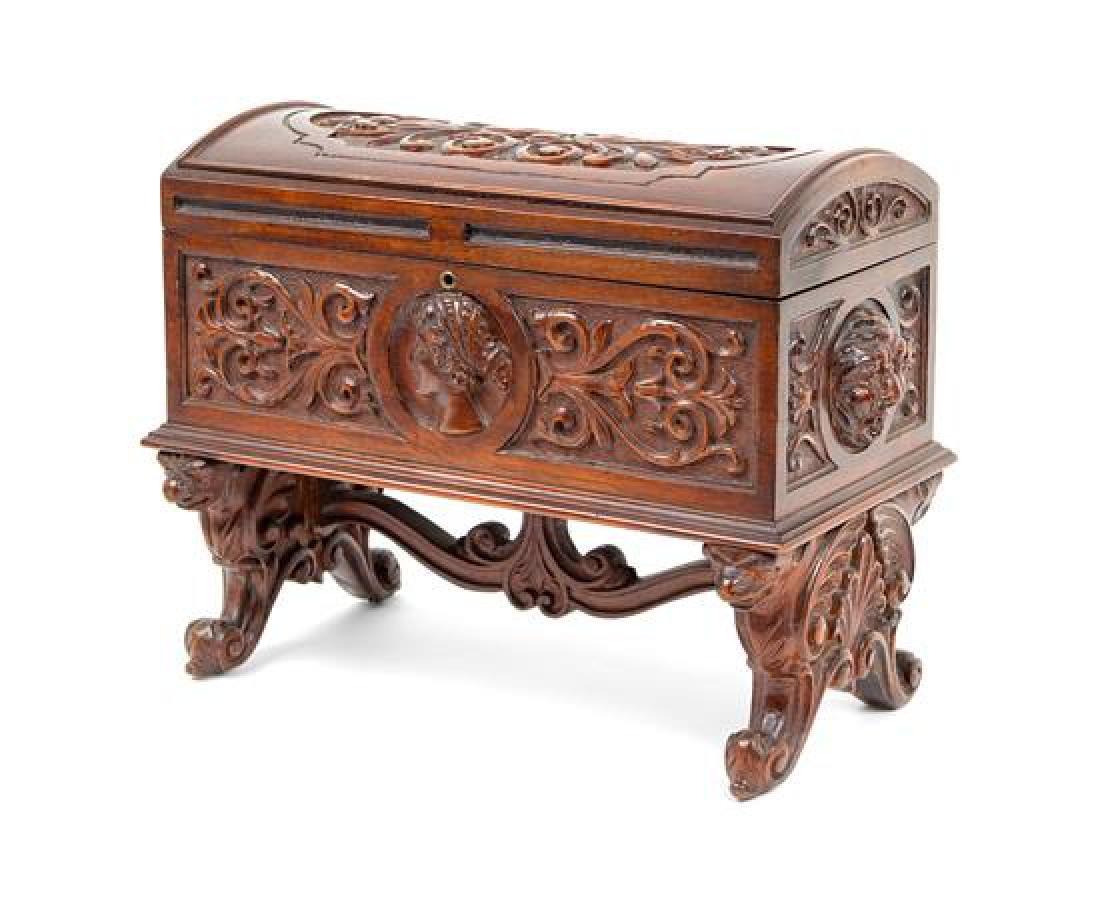 A Continental Carved Walnut Humidor