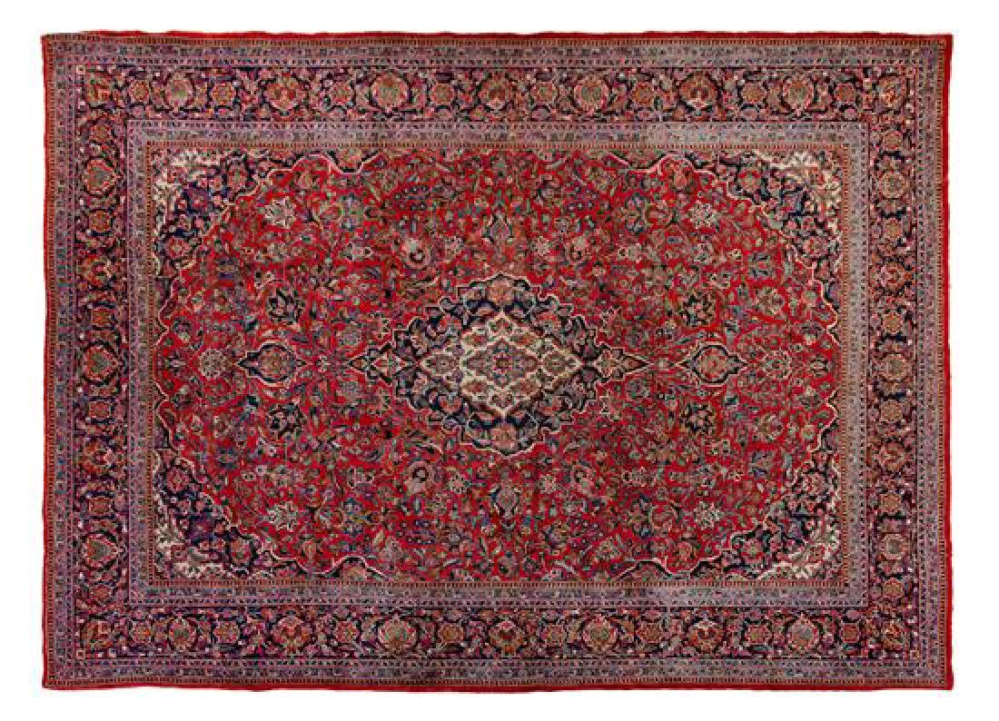 A Kashan Wool Rug 12 feet 3 inches x 9 feet 1 inch.