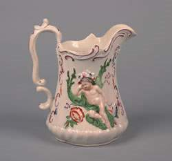An English Earthenware Pitcher, Height 8 1/2 inches