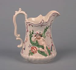 15: An English Earthenware Pitcher, Height 8 1/2 inches