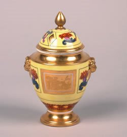 22: A Paris Porcelain Covered Jar, Height 8 inches.