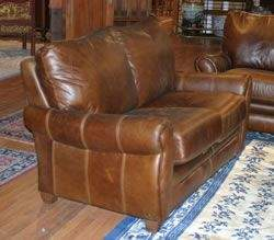 166B: A Suite of Leather Upholstered Furniture,