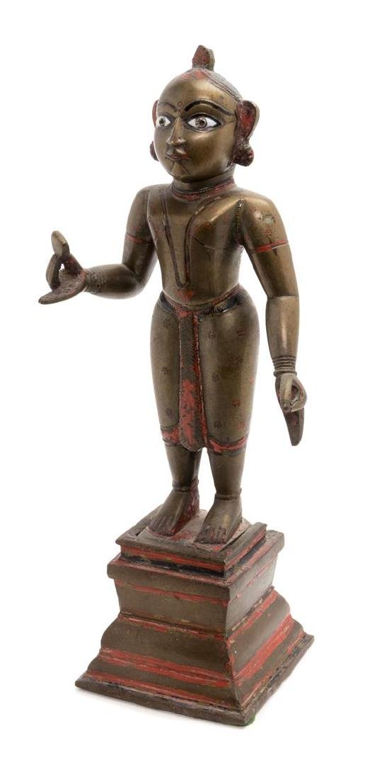 * An Indian Bronze Figure Height overall 14 3/4 inches.