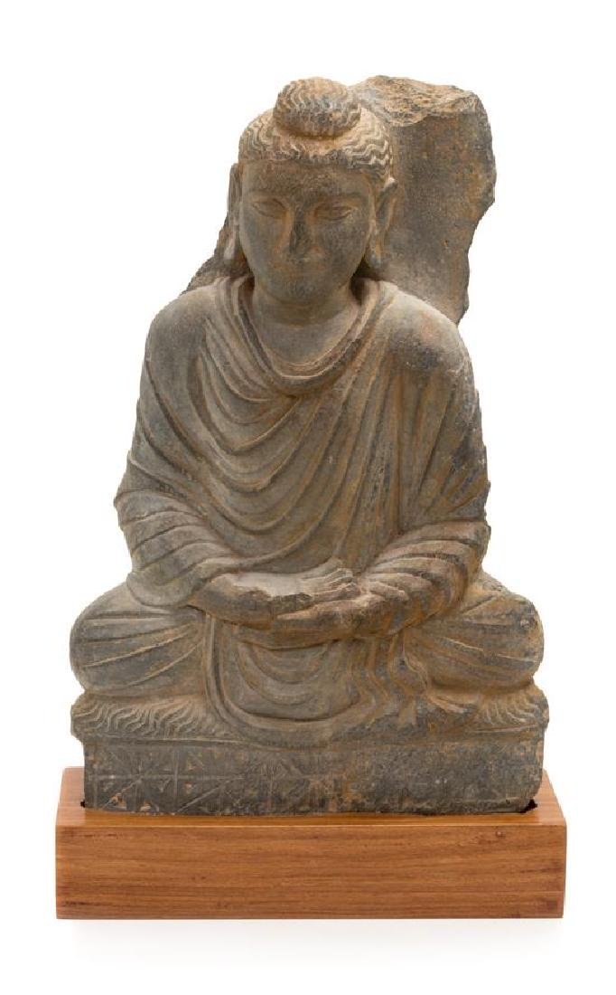 A Gandharan Gray Schist Figure of Seated Buddha Height