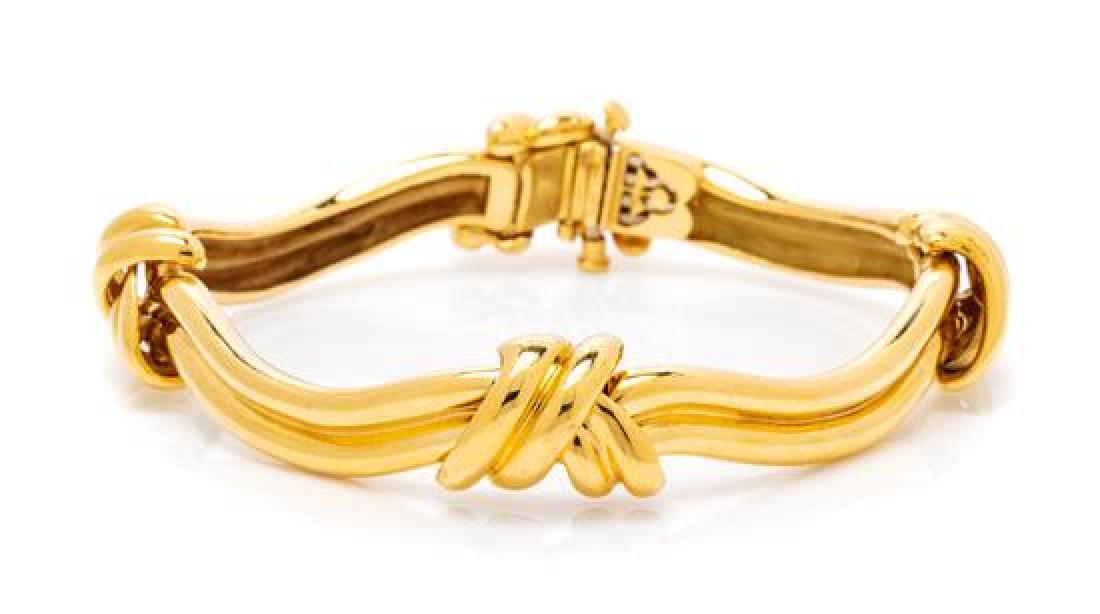 An 18 Karat Yellow Gold 'Knot' Bracelet, Michael
