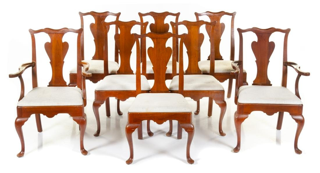 A Group of Eight Dining Chairs Height 38 inches.