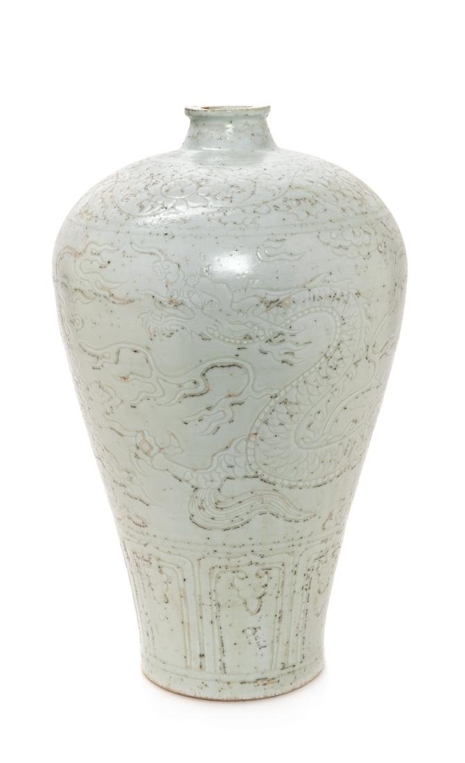 A Chinese Carved White Glazed Porcelain Meiping Vase