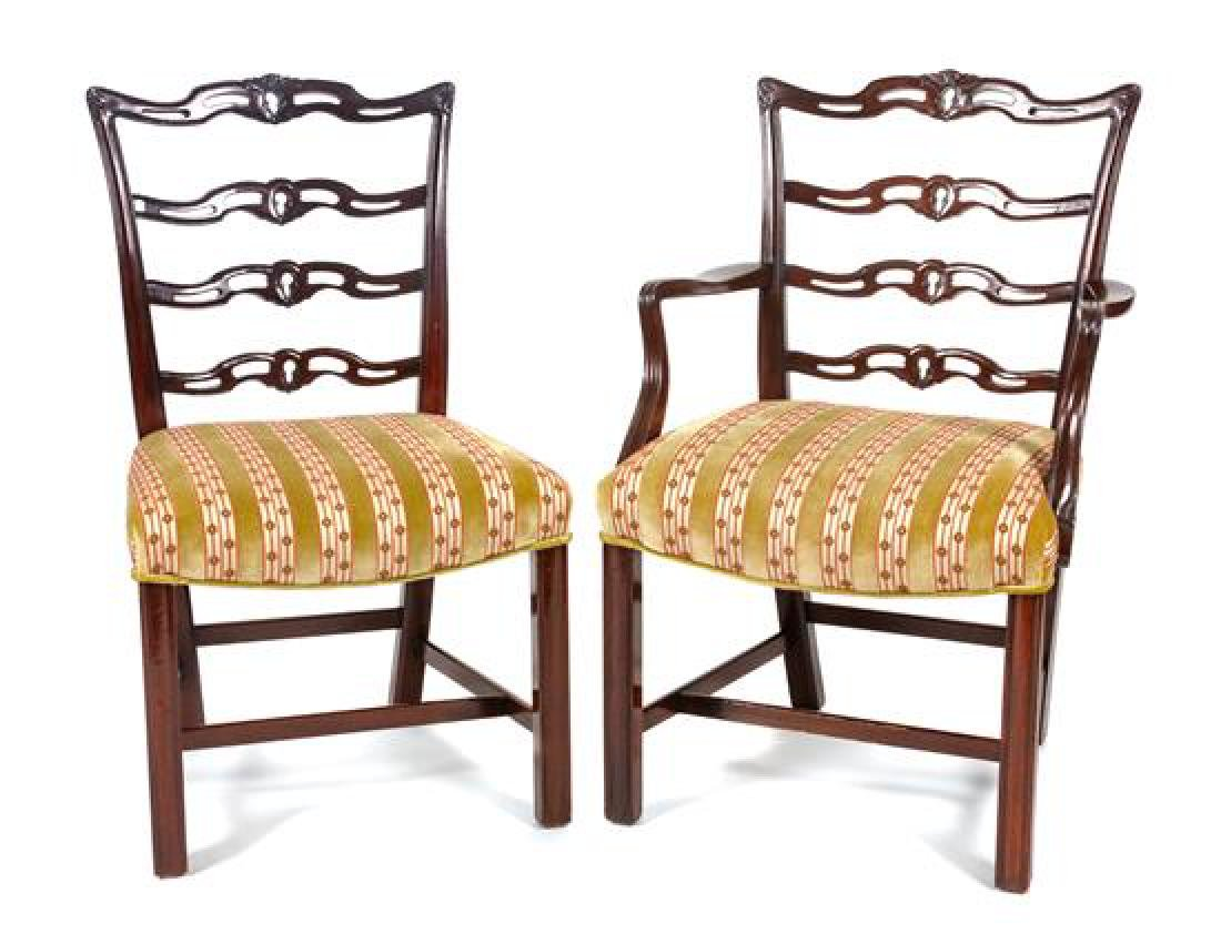 * A Set of Eight Chippendale Style Mahogany Dining