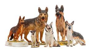 * A Group of Six Porcelain and Ceramic German Shepherds