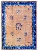 A Chinese Wool Rug 9 feet 5 inches x 5 feet 6 inches.