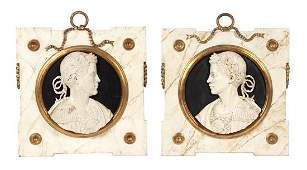 A Pair of Italian Carved and Painted Wood Cameo Plaques
