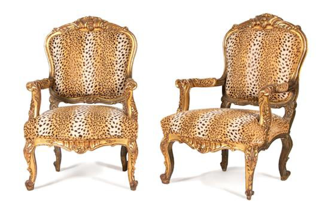 A Pair of Louis XV Style Carved Giltwood Fauteuils