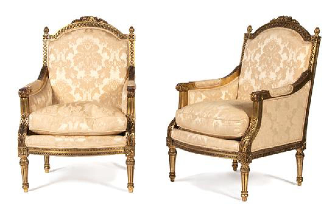 A Pair of Louis XVI Style Carved and Painted Bergeres