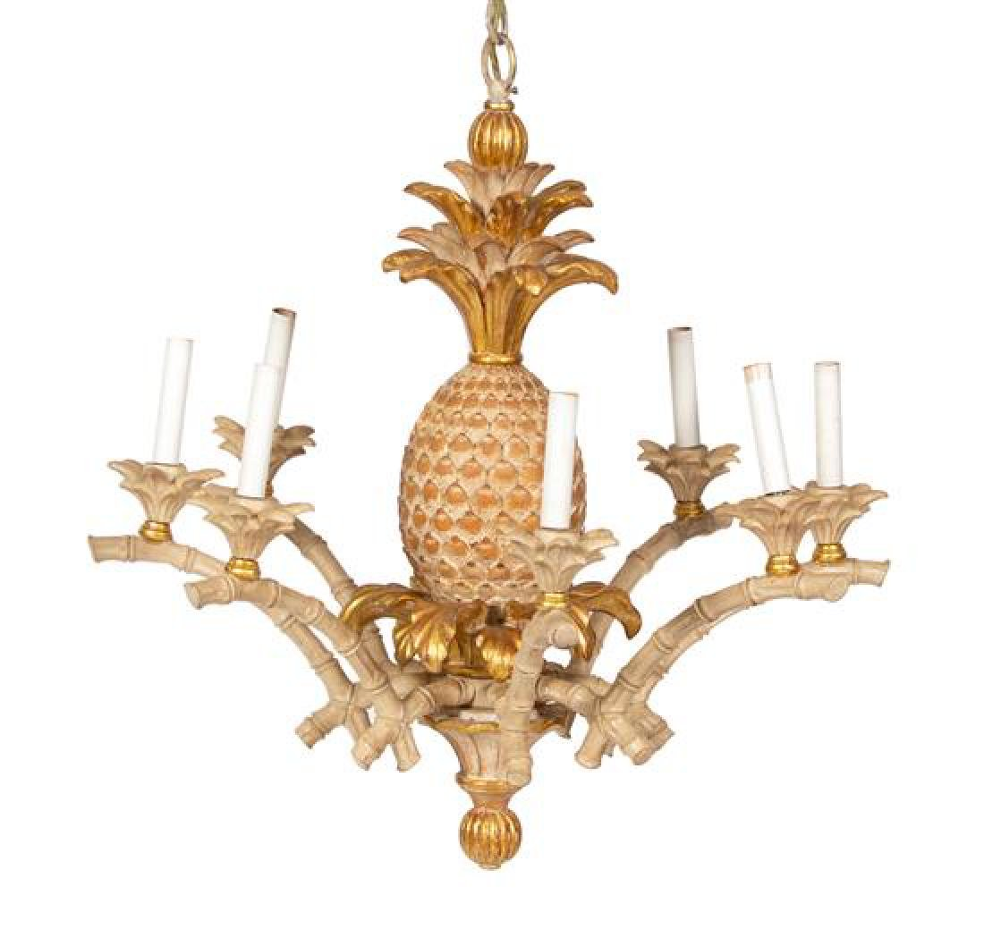 A Carved Painted and Parcel Gilt Eight Light Chandelier