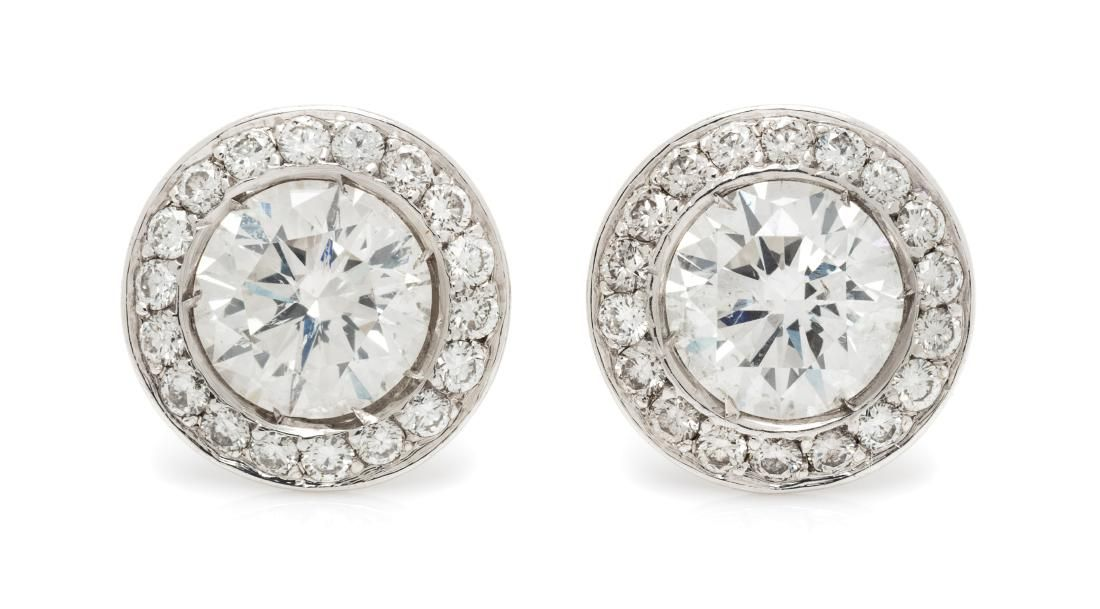 A Pair of White Gold and Diamond Stud Earrings, 1.60