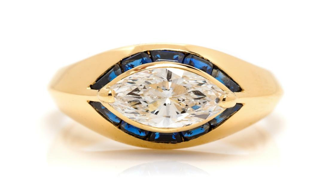 An 18 Karat Yellow Gold, Diamond and Sapphire Ring,
