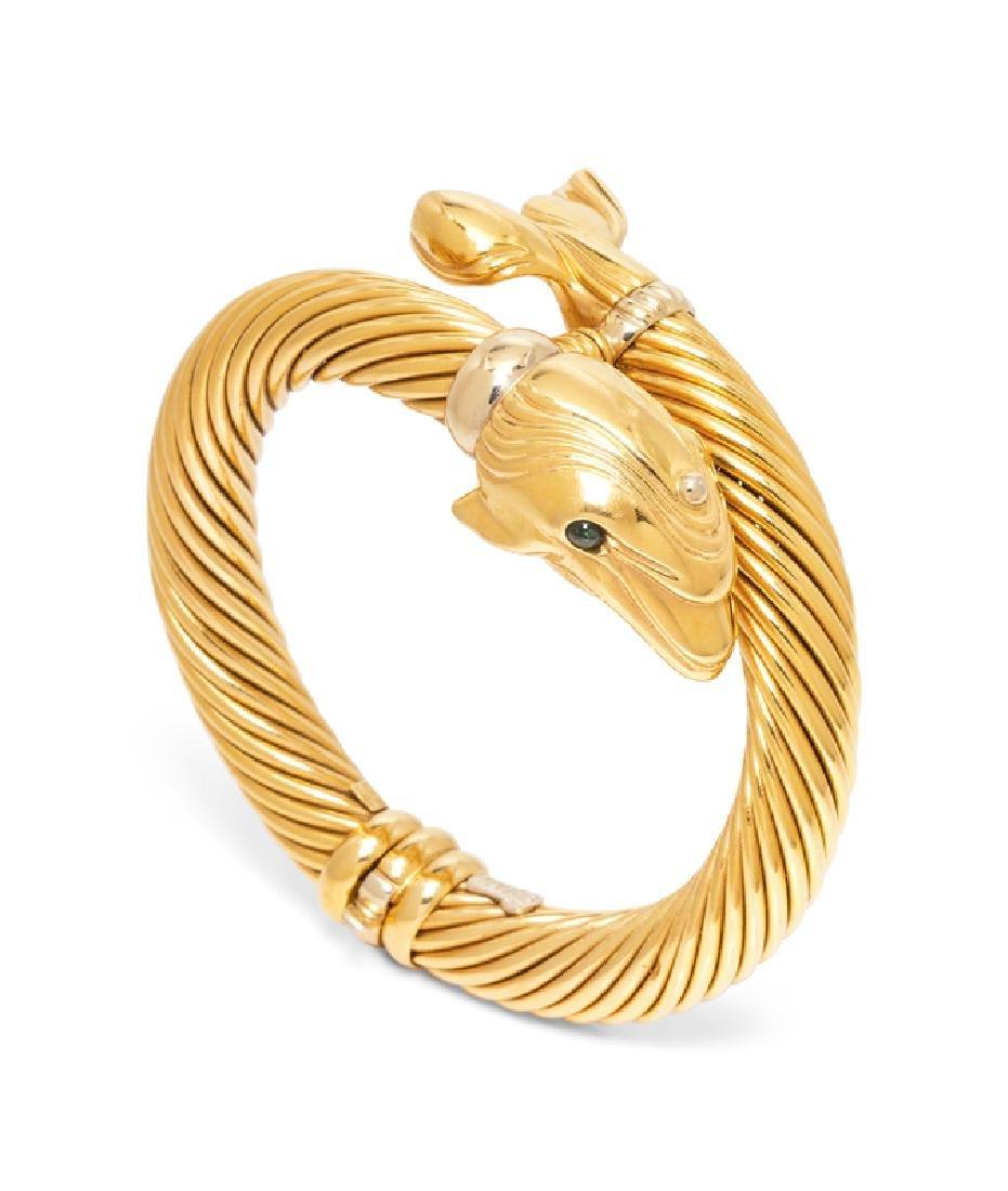 An 18 Karat Yellow Gold Dolphin Motif Bangle Bracelet,