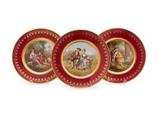 A Set of Twelve Royal Vienna Painted and Gilt Plates