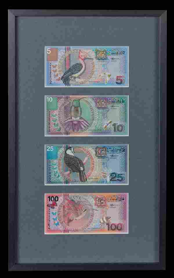 A Framed Group of Four Suriname Series 2000 Bank Notes