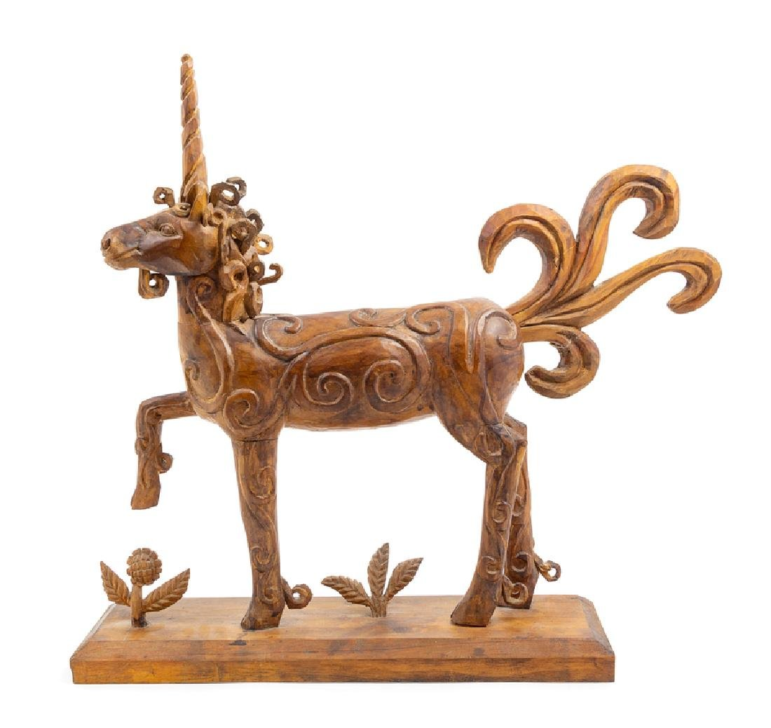 A Carved Wood Unicorn Height 23 x width 24 x