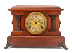 An American Cherry Mantel Clock SETH THOMAS,