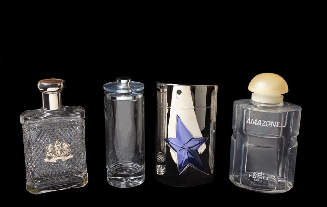 A Group of Four Factice Perfume Bottles