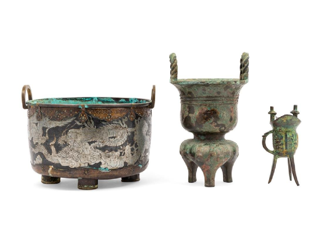 Three Chinese Bronze Vessels 20TH CENTURY the first a