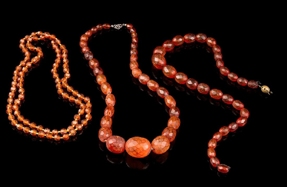 Three Chinese Amber Beaded Necklaces 20TH CENTURY each