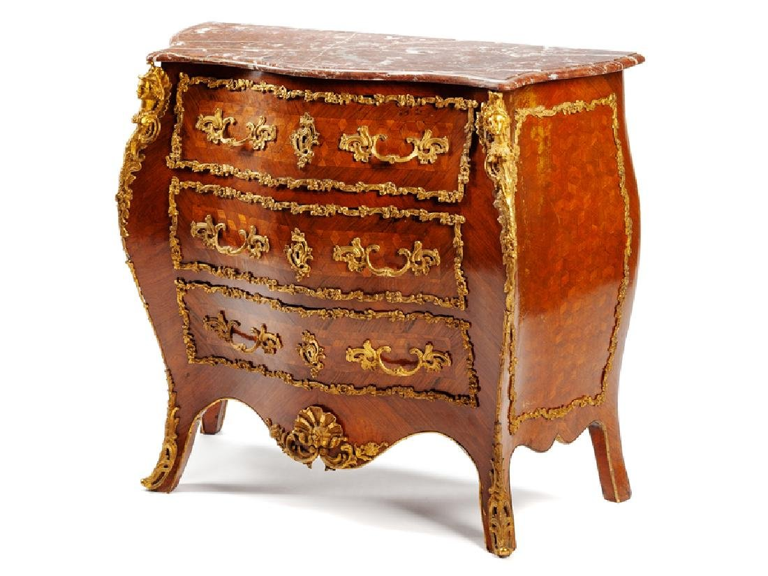 A French Gilt Bronze Mounted Parquetry Chest of Drawers
