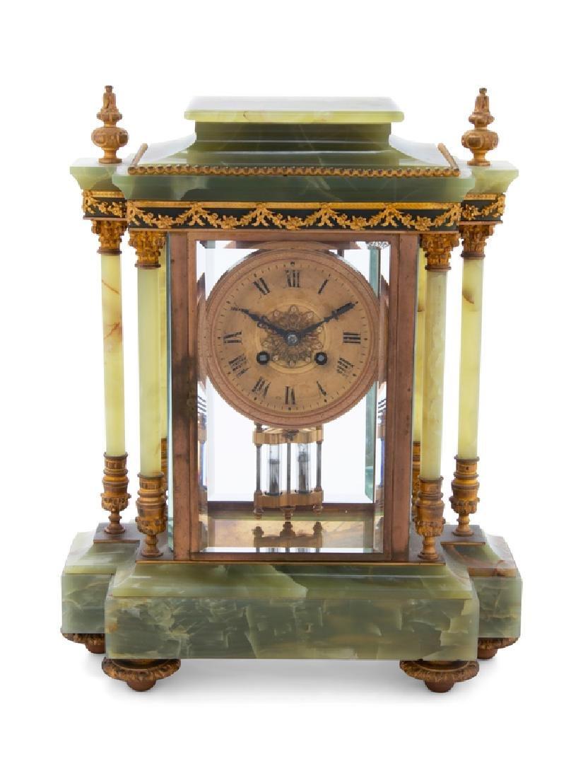 A French Gilt Bronze Mounted Onyx Mantel Clock