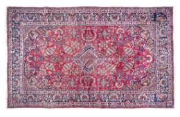 A Persian Room Sized Wool Rug 14 Feet 2 inches