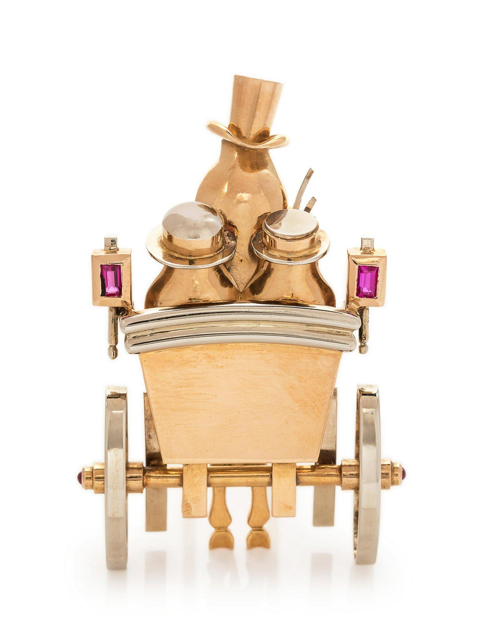A Retro Bicolor 18 Karat Gold and Ruby Carriage Motif