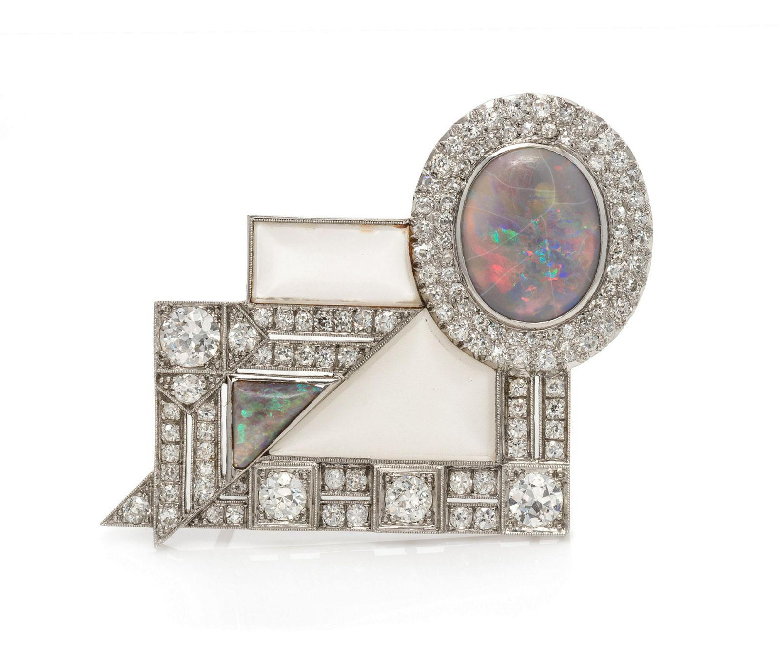 An Art Deco Platinum, Opal, Diamond and Rock Crystal