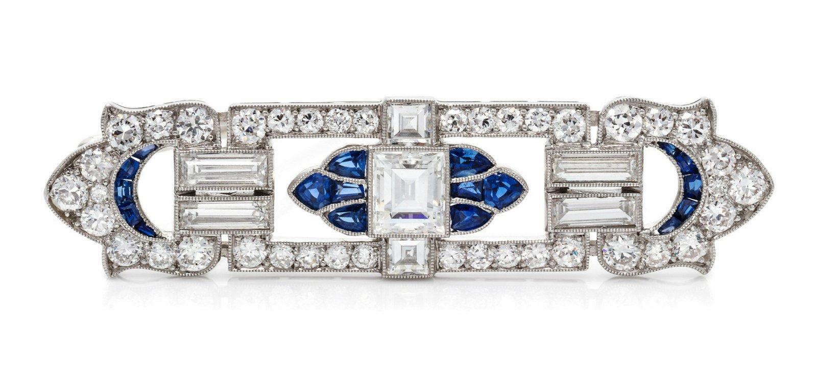 An Art Deco Platinum, Diamond and Sapphire Brooch,