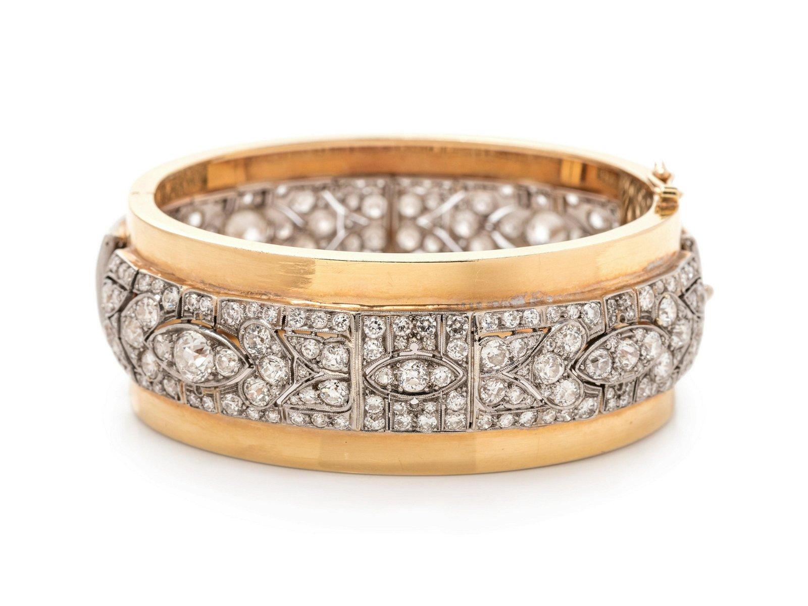 A Platinum, Yellow Gold and Diamond Bangle Bracelet,