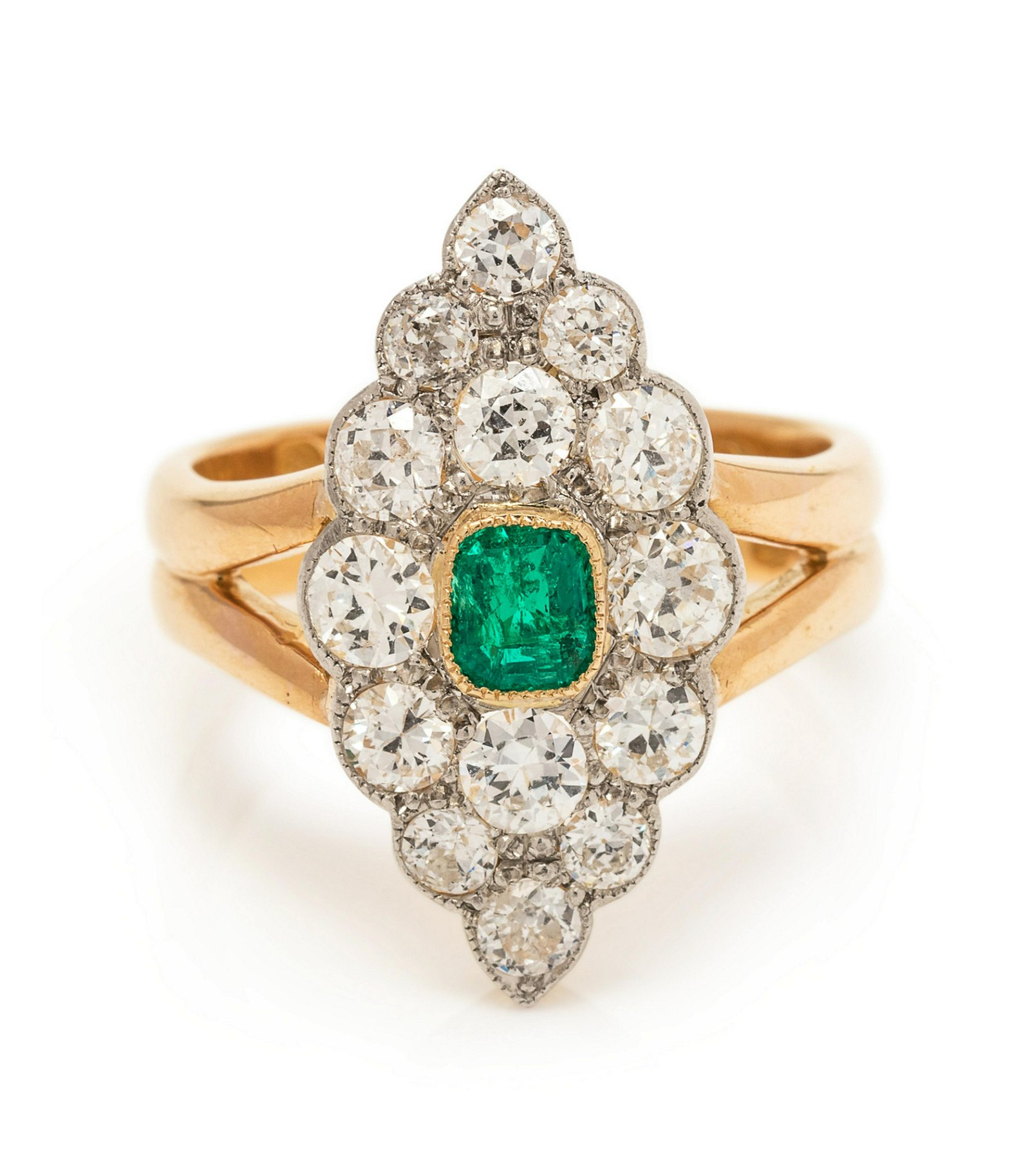 A Platinum Topped 22 Karat Yellow Gold, Emerald and