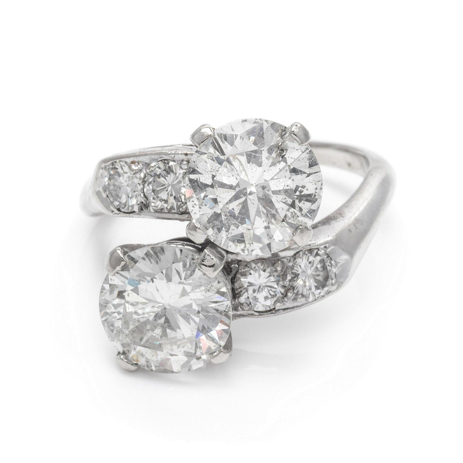 A 14 Karat White Gold and Diamond Toi et Moi Ring,