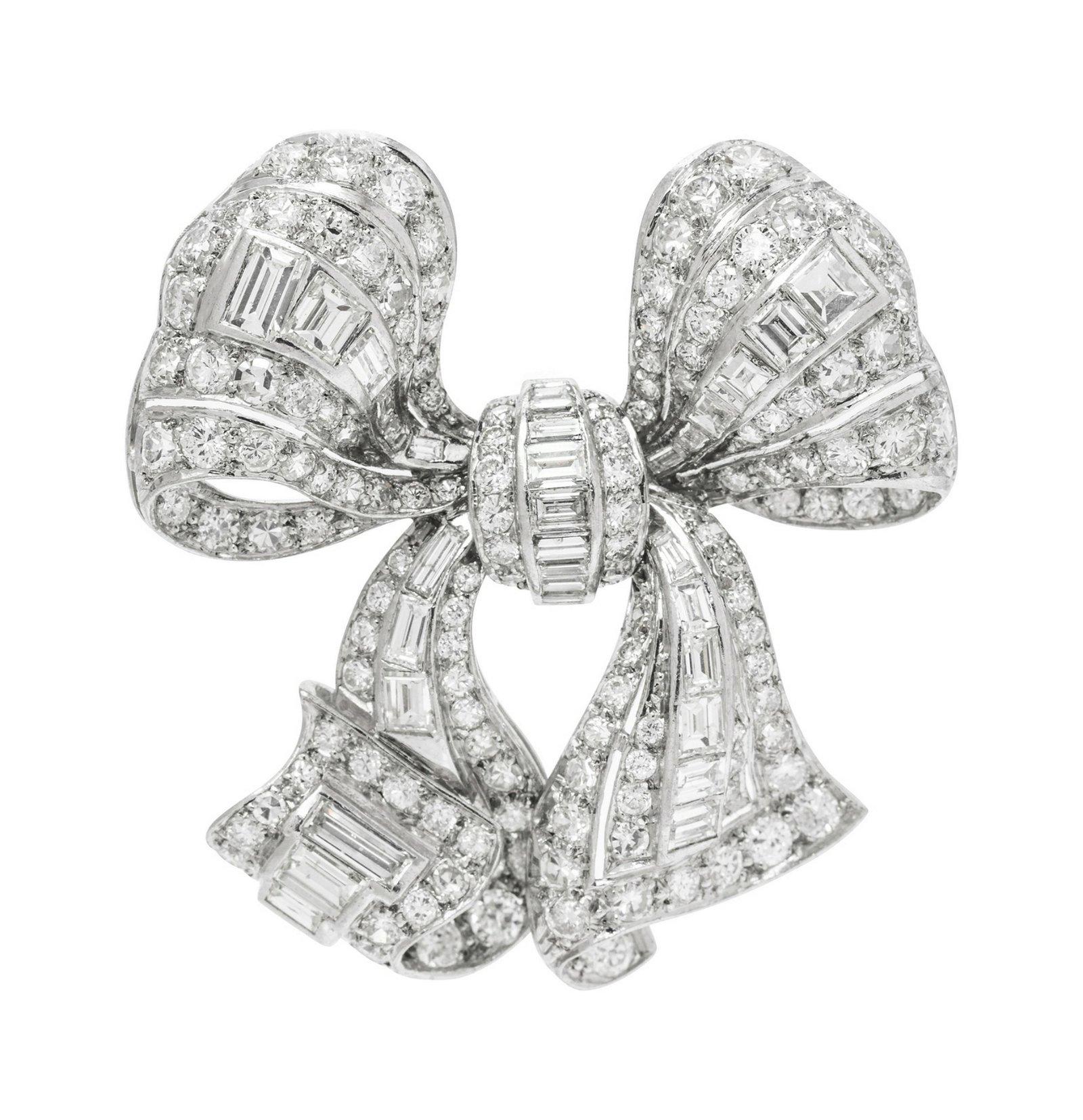 A Platinum and Diamond Bow Brooch,