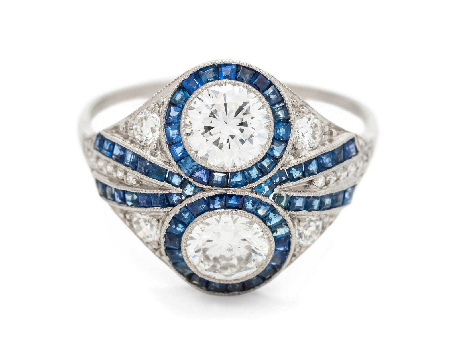 A Platinum, Diamond and Sapphire Ring,